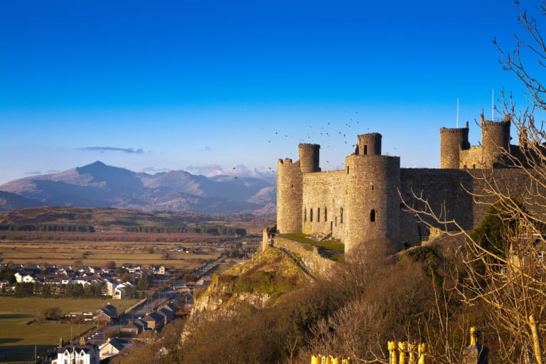 General view from the south with Snowdonia in the background Harlech Castle Cadw Sites World Heritage Sites SAMN: ME044 NGR: SH581312 Gwynedd North Castles Medieval Defence Historic Sites